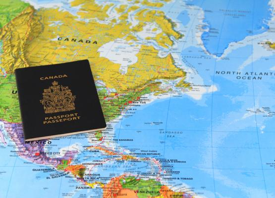 A Canadian passport on a world map