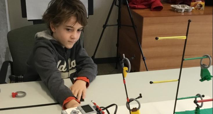 a boy is playing with robots