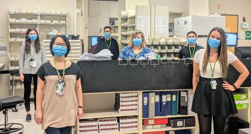 Members of our pharmacy blue team in the pharmacy with masks on