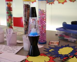 A lava lamp on a table.