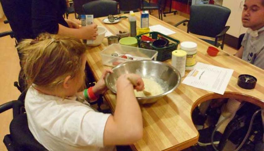 Group baking is one of the many fun activities available in the day program