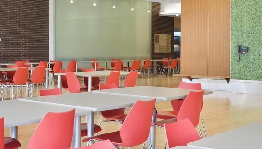 The cafeteria features comfortable seating with lots of natural light
