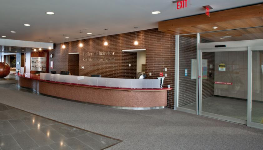 As you enter the hospital through the sliding doors, main reception is to your right