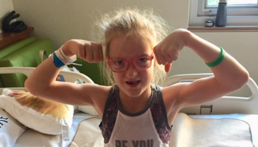 Olivia flexing her muscles.