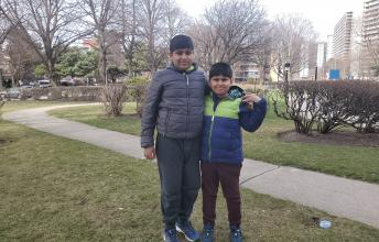 Mahad and Zain outside.