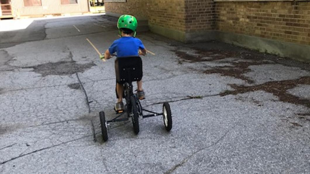 Child pedalling on his bike.